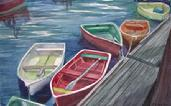 watercolor painting of bright rowboats at a dock