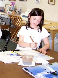 girl painting a watercolor at ARTWORKS